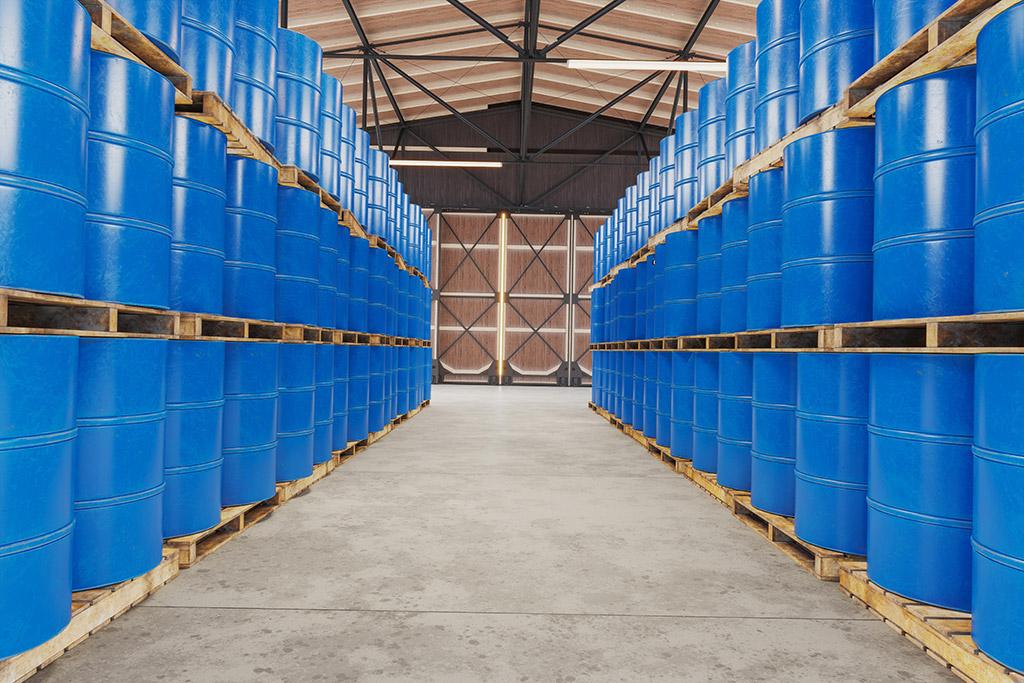 Blue barrels on wooden pallets in warehouse