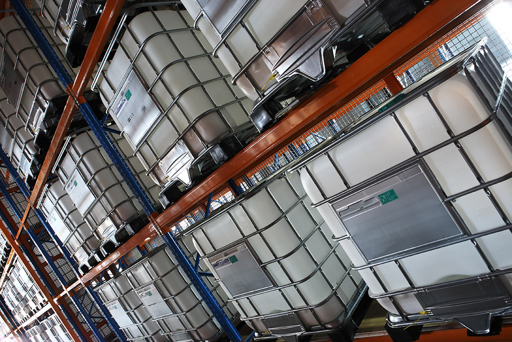 Intermediate Bulk Liquid Containers stacked in Warehouse